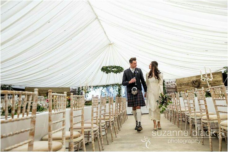 Styling by Through the Looking Glass Scotland. Barn Marquee. Scottish Wedding. Chiavari chairs. Garland chandelier.  Banqueting tables. Rustic wedding. The cow shed crail. @2thlookingglass