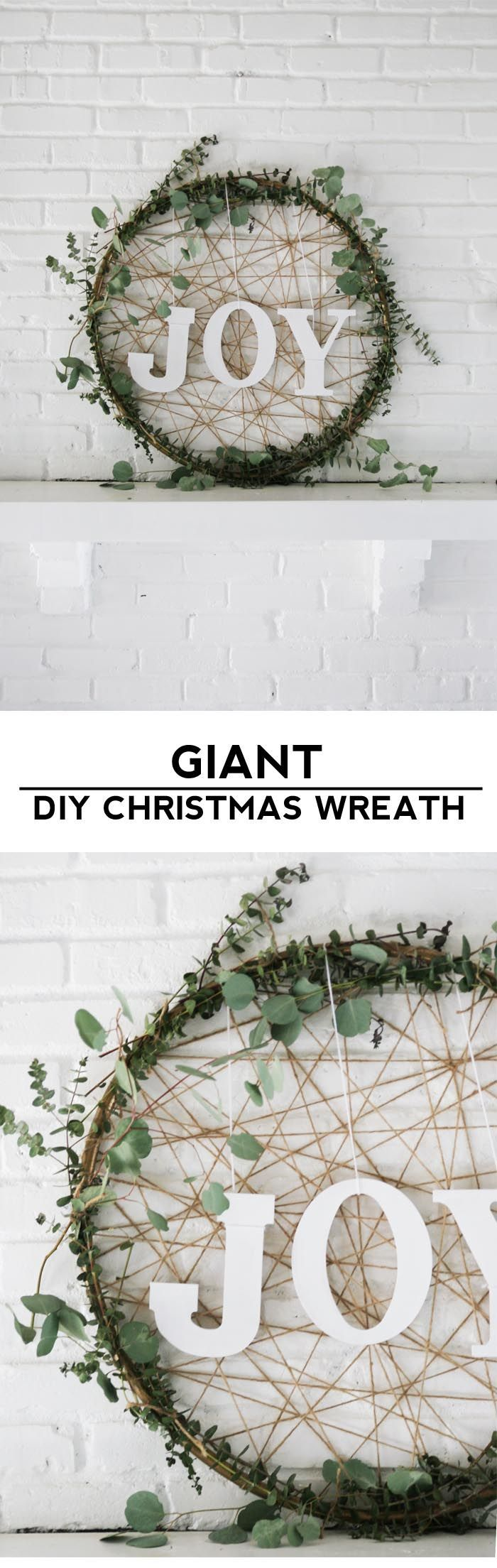 Make a giant DIY Christmas wreath out of a hula hoop and eucalyptus for some rustic and modern Christmas decor!