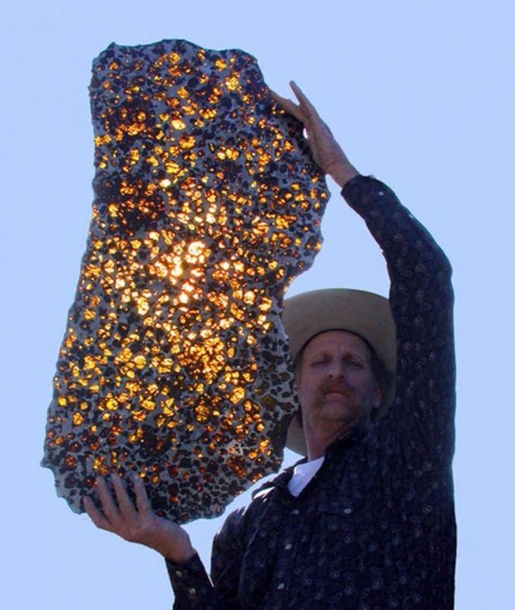 Man holding Fukang meteorite, which has 4.5 billion years