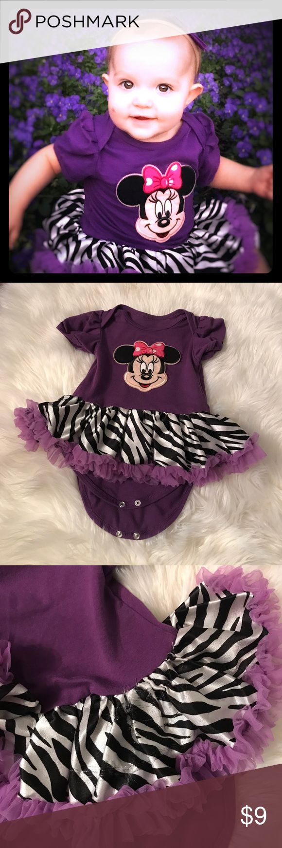 6-12 month Purple Minnie Tutu Dress This has a zebra tutu and was worn one time to Animal Kingdom. The tag was removed because it was itchy. The skirt has a snag on the back, in last pic. Price reflects. Dresses Casual