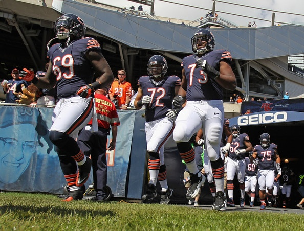 Members of the Chicago Bears run out to the field for warm-ups before the 2012 NFL season opener against the Indianapolis Colts at Soldier Field on September 9, 2012 in Chicago, Illinois.