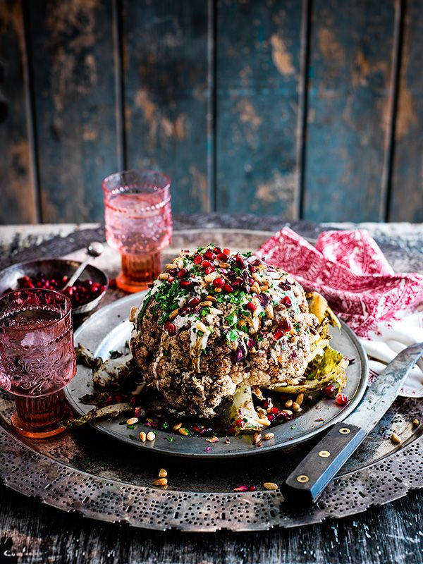 Cauliflower shawarma, pomegranate, tahini and pine nuts - This recipe for cauliflower shawarma, pomegranate, tahini and pine nuts comes from Berber and Q in East London. Serving cauliflower whole like this, fresh from the BBQ is inspired, particularly, when it's smothered in shawarma butter. Serve this by itself, or as a side dish.