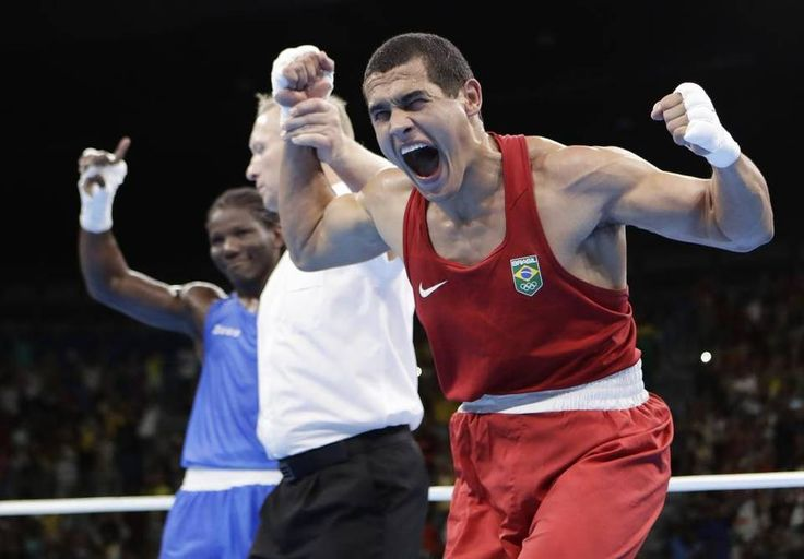 Brazil's Michel Borges, right, reacts after winning a match against Cameroon's Hassan N'Dam during a men's light heavyweight 81-kg…
