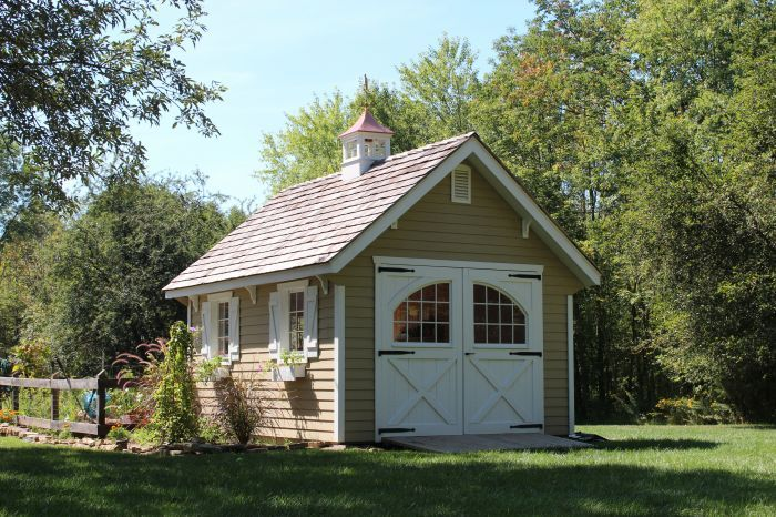 12'x16' Lap-sided Garden Shed with 10-12 pitch roof and 8'x7' Carriage House barn doors by Lapp Structures