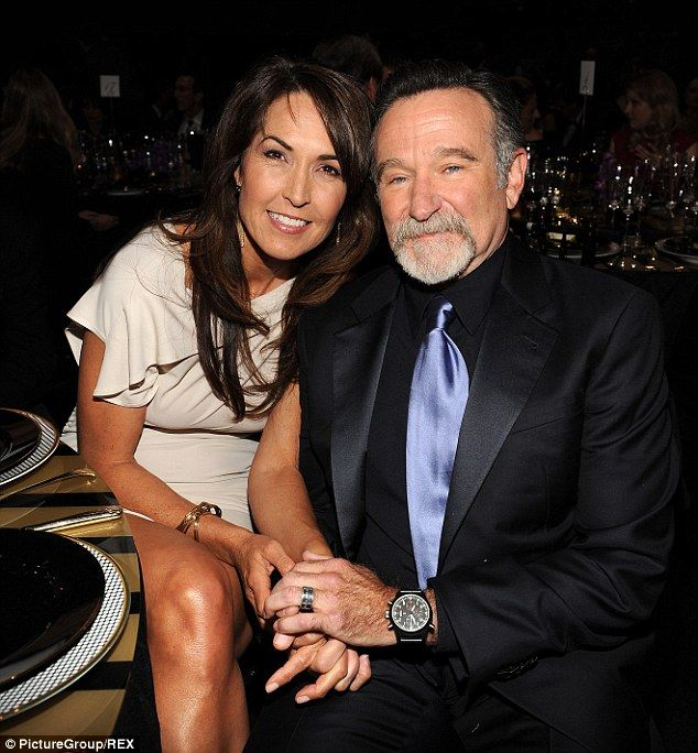 Robin Williams' suicide 'was triggered by hallucinations from a devastating form of dementia' he was battling alongside Parkinson's  Robin Williams with his third wife Susan Schneider. Sources connected with the troubled comic's family told TMZ that the degenerative disease was the 'key factor' they believe drove him to take his own life