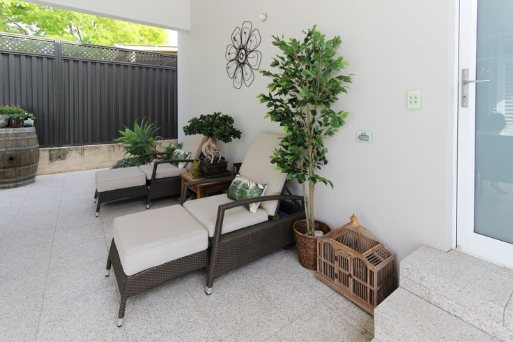Touches of green pop against the light greys and neutral colours in this outdoor setting