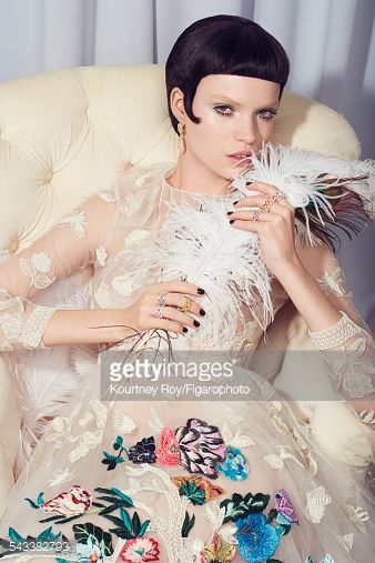 Model poses at a jewelry shoot for Madame Figaro on November 17, 2014 in Paris, France. Earrings . Left: My Dior rings , Aria ring . Right: Rings . Dress . Make-up by Dior. PUBLISHED IMAGE.