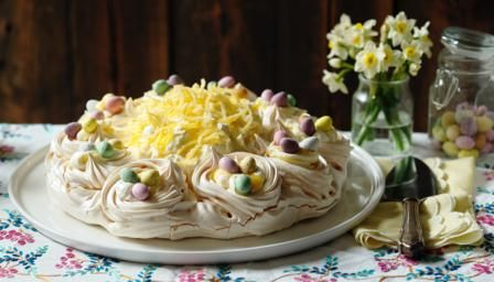 If you're looking for something different for an Easter dessert, this stunning pavlova from Mary Berry should do the trick: lemon curd pavolva topped with mini-mounds of meringue and chocolate eggs.