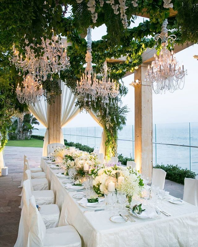 Custom Chair Covers Matching The Tabletop Linen Created An Elegant White Foundation The Table Tops Wedding Inside Wedding Chandelier Wedding Reception Dinner