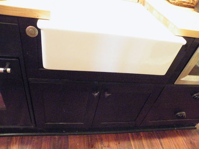 More on undermounting farmhouse sinks. This looks to be a cutout of a cabinet door. Note the air switch for the garbage disposal.