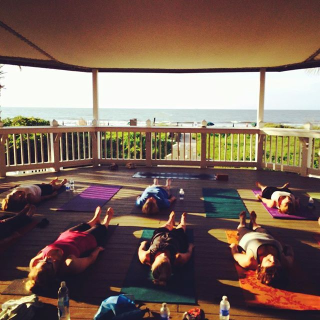 Renew with a view! Our group guests kicked off their corporate retreat by the sea this morning with beachfront yoga courtesy of I Do.Yoga Charleston. #nationalyogamonth #meetinthewild