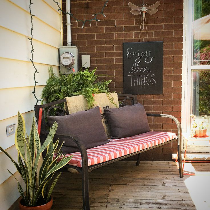 Little reading nook in a corner of the patio.  Plants = Cozy for me!