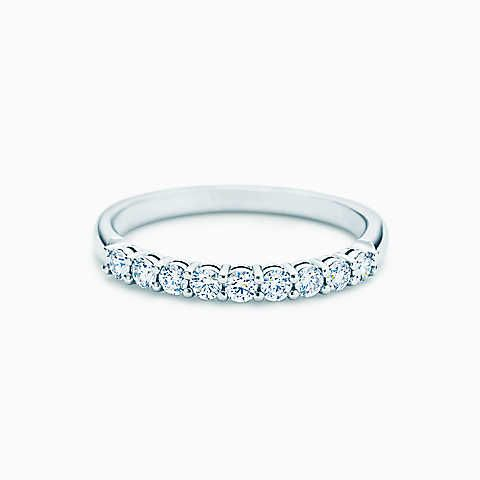Shared-setting band ring with diamonds in platinum, 2.2mm wide.