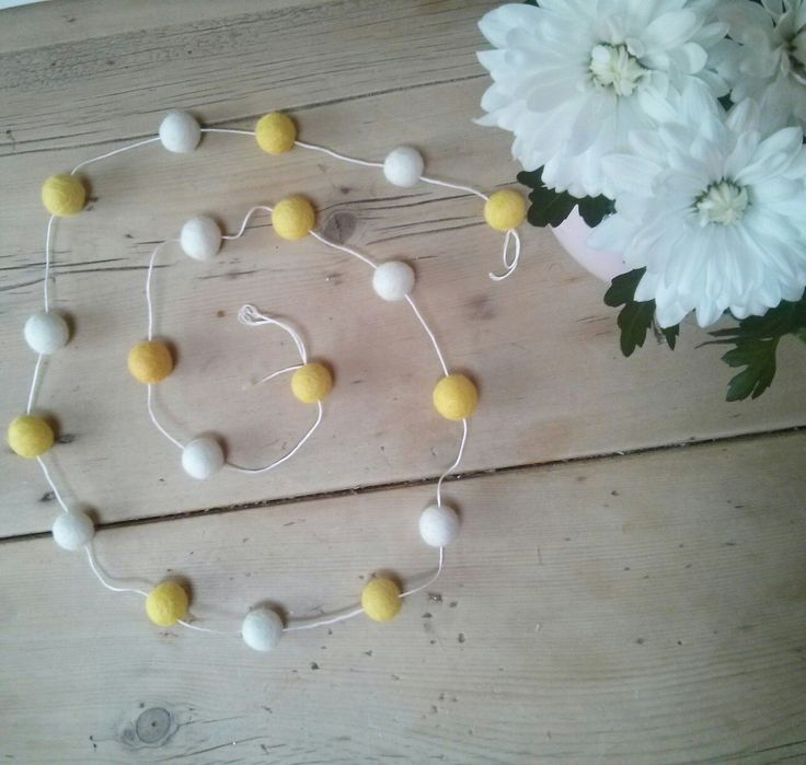 Daisy chain feltball garland... Beautifully refreshing colours. Perfect for a nursery perhaps?