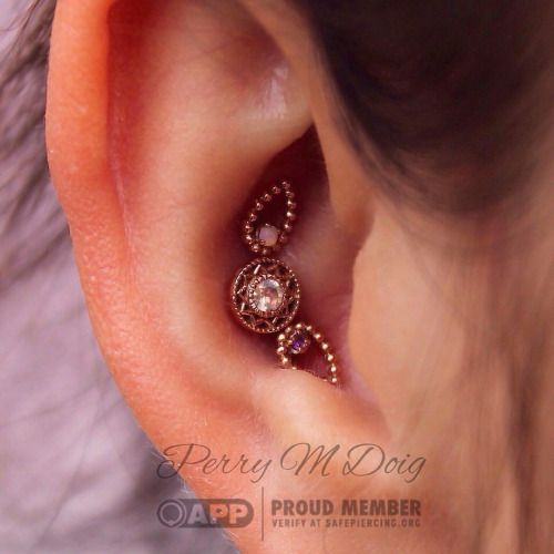 "perrymdoig: ""One of my favorite projects to-date. Triple conch piercing featuring three rose gold stunners from @bvla. The top ""Melody's Tear"" features a AAA white Opal, the bottom one features a AA amethyst, and the ""Bandera"" in the center features..."