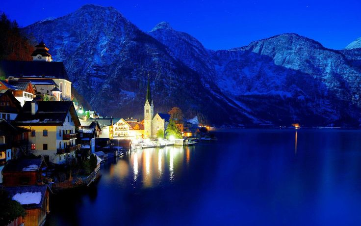 The storybook town of Hallstatt in central #Austria enjoys a gorgeous setting on the bank of the Hallstätter See, between the pristine #lake and a lush #mountain that rises dramatically from the water's edge. #Travel