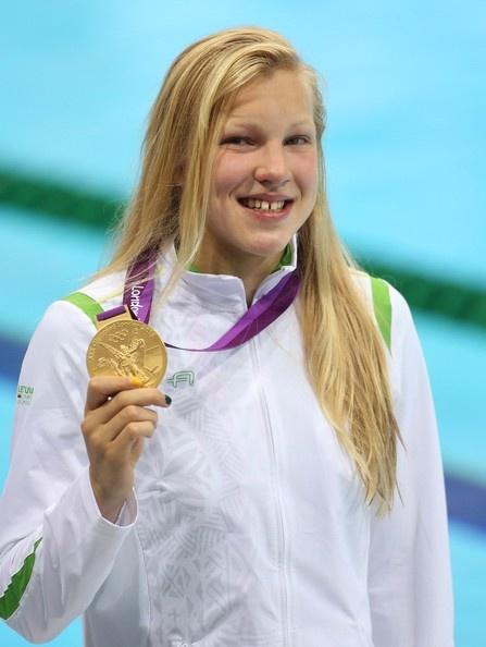 Ruta Meilutyte of Lithuania wins gold medal in women's 100m breastroke