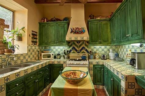 Mexican tiled kitchen with hand-painted tiles and talavera pottery accents #agavesanmiguel #sanmiguelrealestate