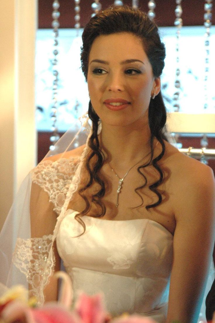Sweep with slight curl & crown veil for the Bride