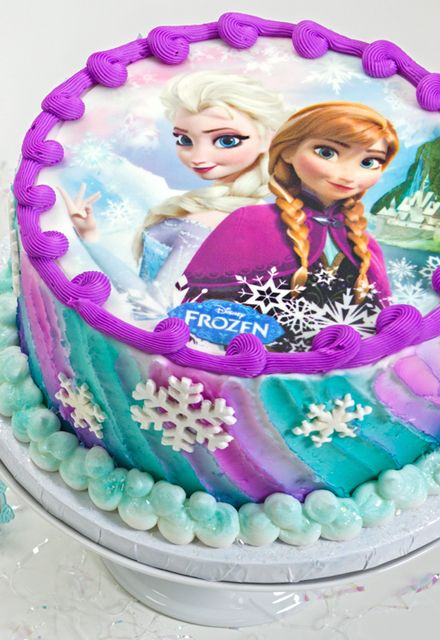 Make the best Frozen cake ever with the official PhotoCake Edible Cake Image, featuring a photo of Anna and Elsa that you can eat.