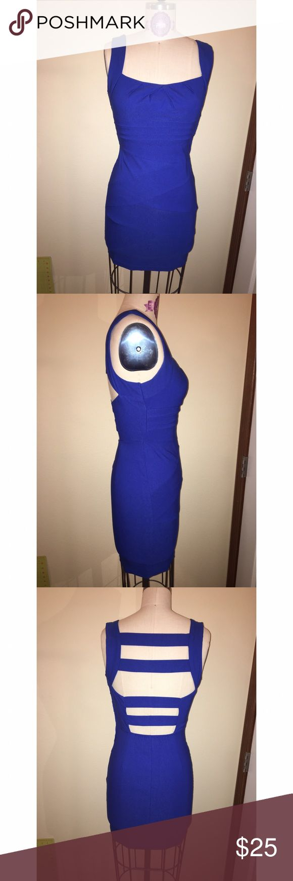 Blue bodycon dress w/ strappy back Blue bodycon dress. 76% rayon, 21% nylon, and 3% spandex. 100% polyester lining. Unique criss-crossing fabric detail on front. Built in bra cups. Four straps across the back. Emerald Sundae Dresses Mini