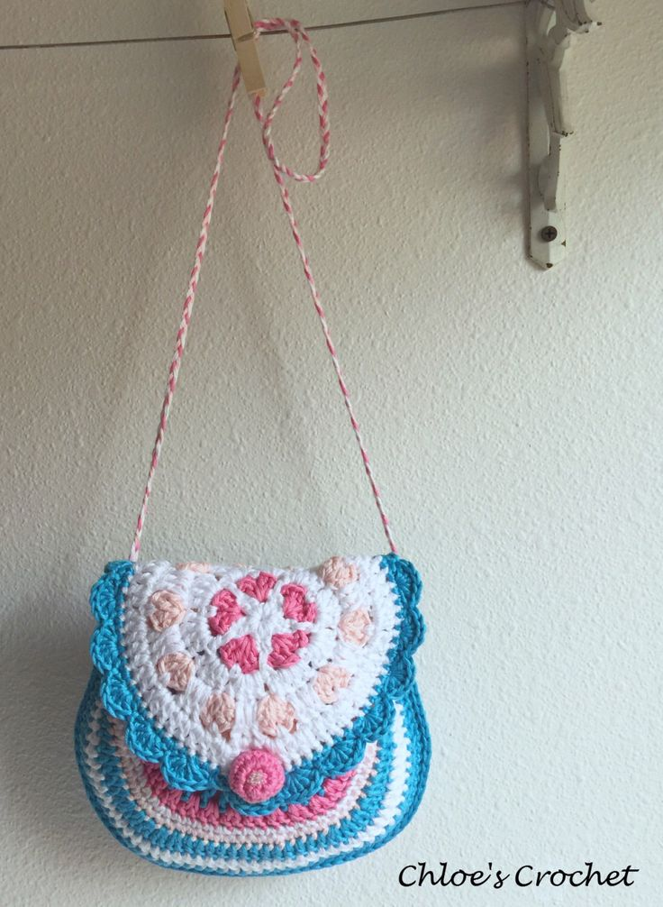 A personal favorite from my Etsy shop https://www.etsy.com/listing/227312452/crochet-colorful-heart-purse-the-spring