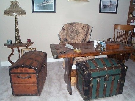 Nautical treasure chests: would be perfect for a baby pirate nautical nursery or kids room http://www.thepirateslair.com/images/nautical-naval-chests-hatch-cover-desk.jpg