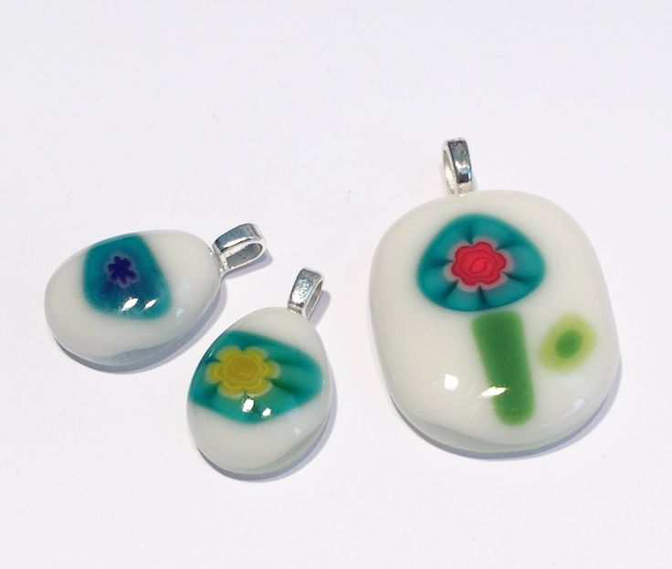 A personal favorite from my Etsy shop https://www.etsy.com/listing/476320256/set-of-3-murano-inspired-millefiori