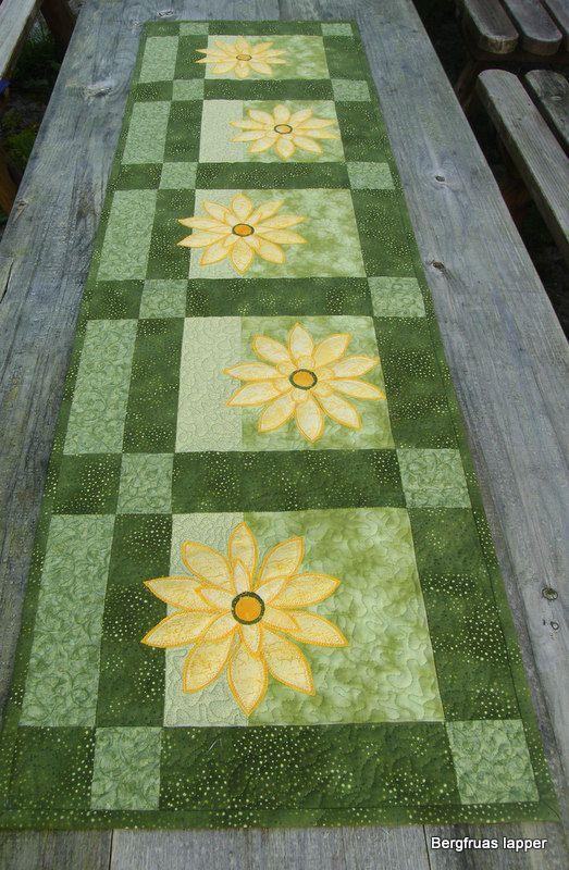 Pretty Yellow Daisy Appliques adorn this pretty green Table Runner.