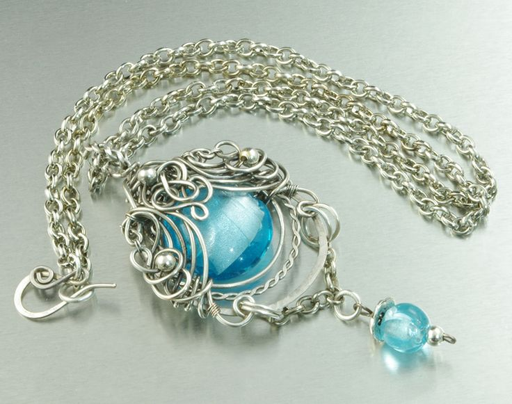 """Gorgeous silver plated pendant, with blue Lampwork in a original silver braid. Beautiful, remarkable pendant, for a woman who likes unique jewelry :)  Size/Dimensions: Length of the chain - 50 cm regulation (19.69""""); Pendant diameter is - 8,5 cm x 4 cm (3.35"""" x 1.57""""); On request I make a similar pendant in other material - silver, copper, brass, silver-plated copper, bronze. Interested persons are welcomed to contact :)"""