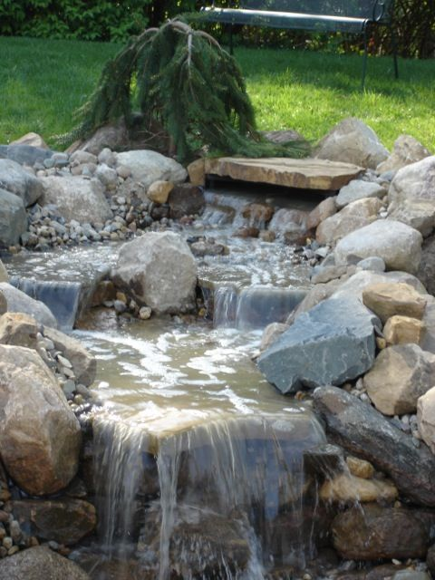 Indiana field stone boulders and an aquascape pond less for Landscaping rocks indianapolis