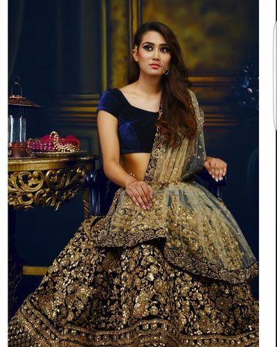 Bridal Lehengas - Navy Blue Velvet Blouse with Gold and Bronze Fully Embroidered Lehenga | WedMeGood #wedmegood #indianwedding #indianbride #navy #blue #gold #net #dupatta #choli #lehenga