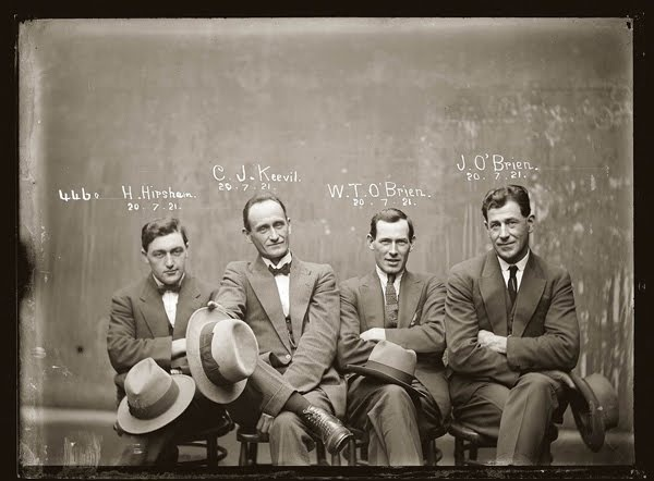 Australian history : Mug shot of Hampton Hirscham, Cornellius Joseph Keevil, William Thomas O'Brien and James O'Brien, 20 July 1921, Central Police Station, Sydney. (Photo by NSW Police Forensic Photography Archive, Justice & Police Museum, Histiric Houses Trust of NSW).
