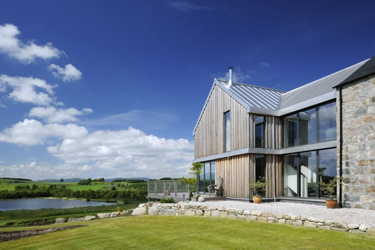At Bogindhu, a refurbished farmhouse plus 'contemporary barn', VELFAC glazing complements both a traditional building and an architecturally innovative extension, while also making the most of some wonderful views.