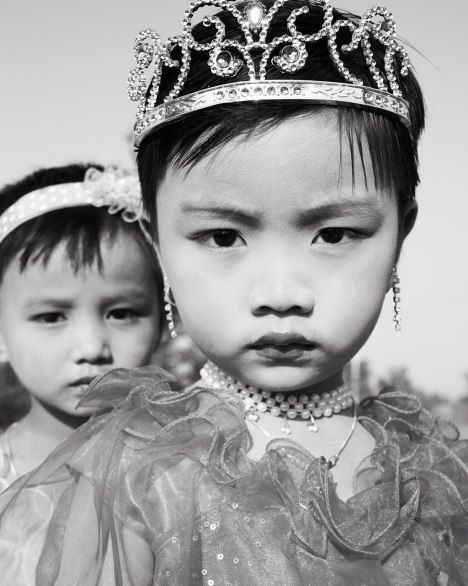 These girls in Mrauk U are all dressed up for a ceremony inducting boys between the ages of eight and twenty as novices into Buddhist monkhood. They generally spend a week or more in a monastery.