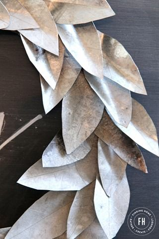 This galvanized sheet metal wreath makes me think of using old spoons instead of cutting all the leaves out. Wonder how that would work?