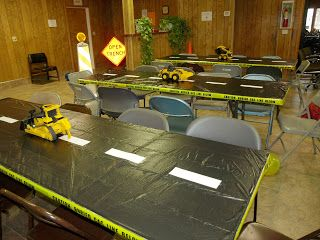dump truck birthday party supplies | Table-top decorations. The tables are lined with black trash bags, and ...