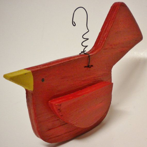 This adorable Cardinal Christmas Ornament is great to hang on a Tree or just about Anywhere! Each is handmade of plywood that is layered and painted. A coiled wire hanger has been added for hanging. All ornaments are cut from wood that has natural marks and imperfections so each Cardinal Ornament is unique. Please allow 1 to 2 weeks to craft depending on quantity ordered and workload at the time of purchase. Measures approximately 6 W x 3 H (5 H at tail) x 1 3/8. Intended for Decorative Use…