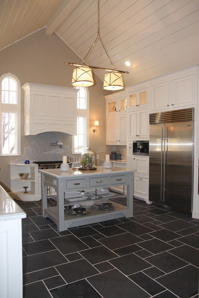 Charcoal Tile Floor With White Cabinets Kitchen