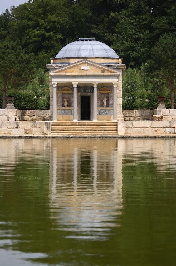 le Chateau du Champ de la Bataille exterior: Temple de Leda reflected in pond, in chateau's gardens.