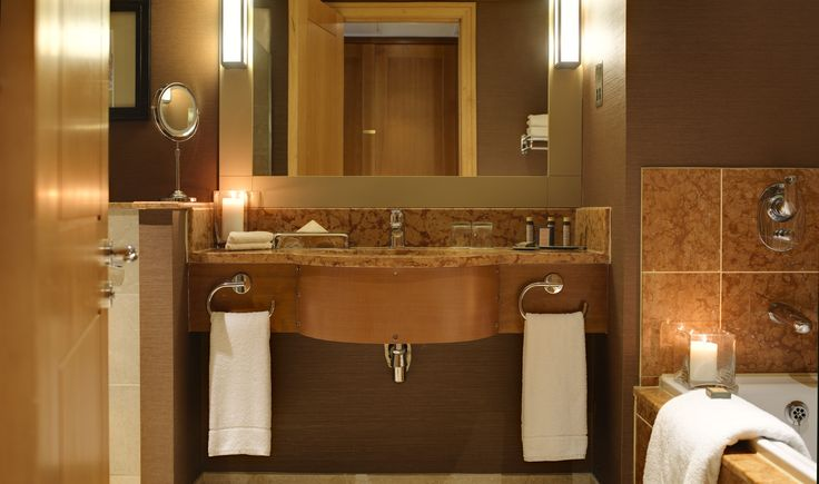 Bathroom in the deluxe guest rooms with separate bath & shower
