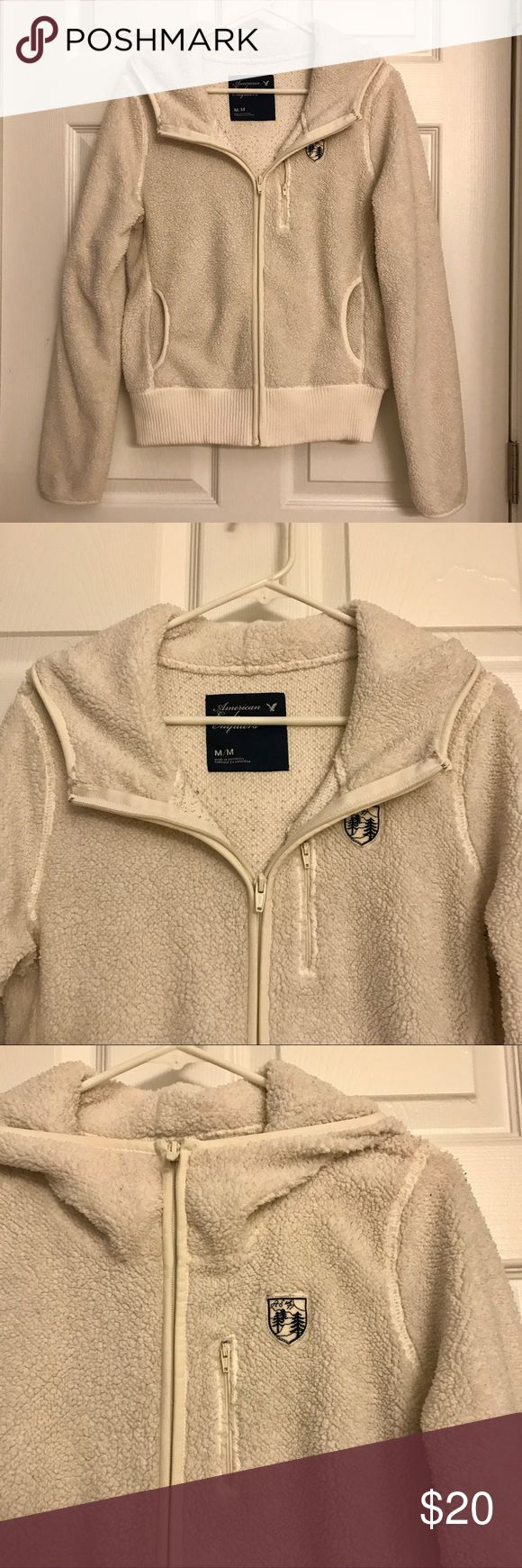 Fuzzy American Eagle Zip Up Jacket Women's zip up jacket • Fuzzy and cozy material • Bought from American Eagle • Cream color • Pockets • Hood • Pilling on inside of jacket (see picture) • American Eagle Outfitters Sweaters