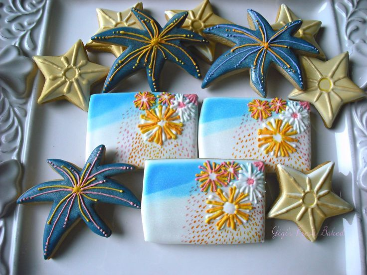 Fireworks! - These cookies were designed using RI, airbrush and hand painted techniques. The bright bursts light  up the stars and the night sky for these firework cookies!  Gigi's Fresh Baked