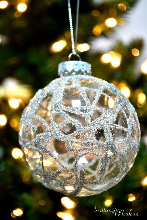 Very easy. Apply glue to outside of clear glass ornament and sprinkle with glitter.