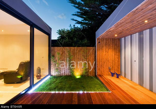 Modern Contemporary Home at Night-time. © Gareth Byrne / Alamy