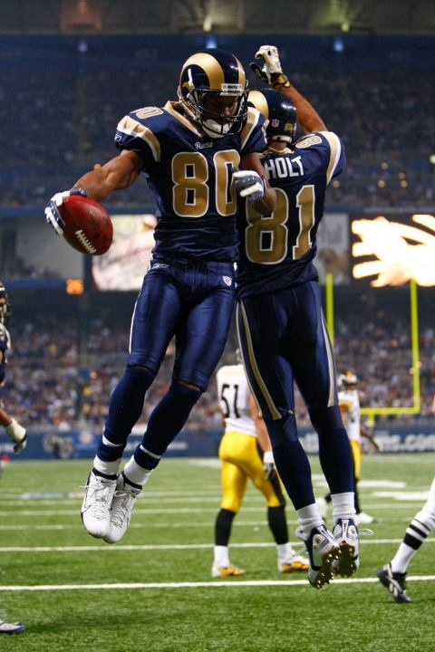 """Torry Holt & Isaac Bruce members of St Louis Rams """"Greatest Show on Turf"""" era."""