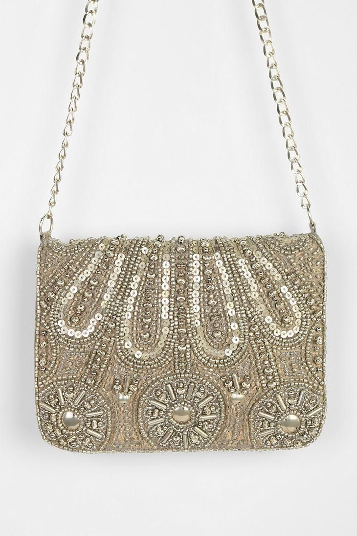 Party perfect, ultra-glam beaded clutch. #urbanoutfitters
