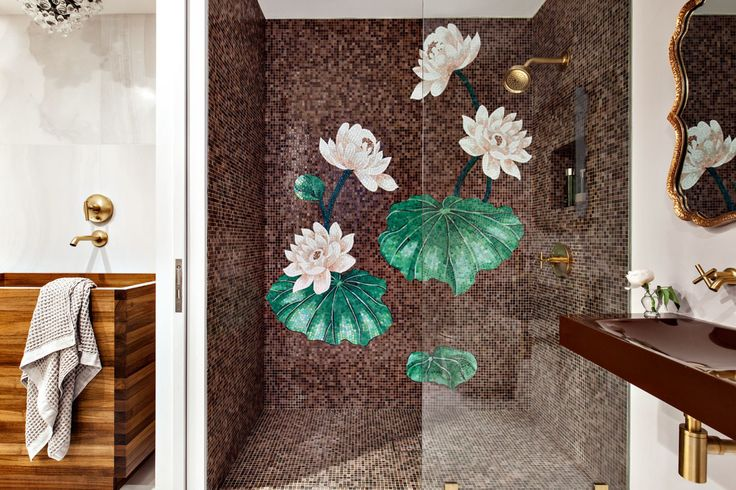In the shower, another Sicis mosaic covers the wall, this time in a lotus pattern, recalling the client's Buddhist beliefs.