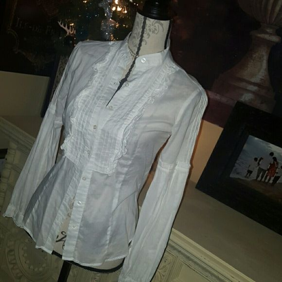 AMERICAN RAG This is a ruffled American Rag blouse, very detailed sleeves and front lapel, 8 buttons up the front. Worn one time incredibly sassy on. Was born with the vest in my store American Rag Tops Blouses