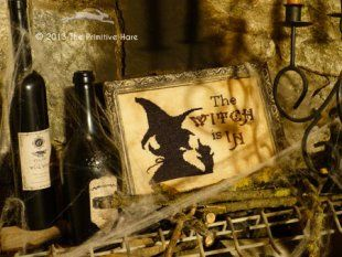 """Please note shipdate! """"The Witch Is In"""" is the title of this cross stitch pattern from The Primitive Hare. A great witch design!"""